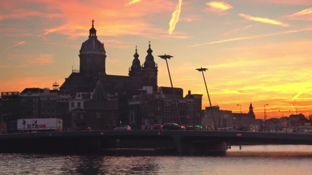 Amsterdam,01/06/2018:silhouette of saint nicholas basilica at sunset