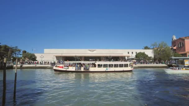 Venice 01/03/2019:tourist boat ferry passing in front of train station venezia italy