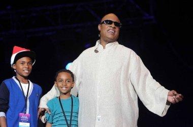 Rio de Janeiro, December 25, 2012.Cantor and pianist Stevie Wonder with their children Kailand Morris and Mandla Morris during their Christmas day show on Copacabana Beach in the city of Rio de Janeiro