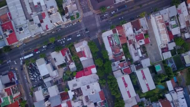 Drone over an Avenue in a suburb of Buenos Aires city with houses and building all around