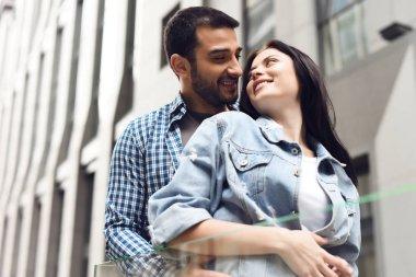 Couple in love near glass barrage. Happy look. Romantic concept.