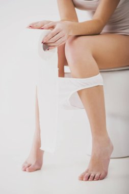 Close up.Woman in toilet isolated on white