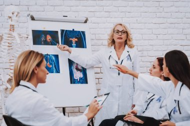Doctor Speak with Young Student. Stethoscope and Nurse. Profession Doctor Medicine and Oncology. Consultation with Doctor. Profession Pharmacy Study. Therapy for Student. Work and Uniform for Student.
