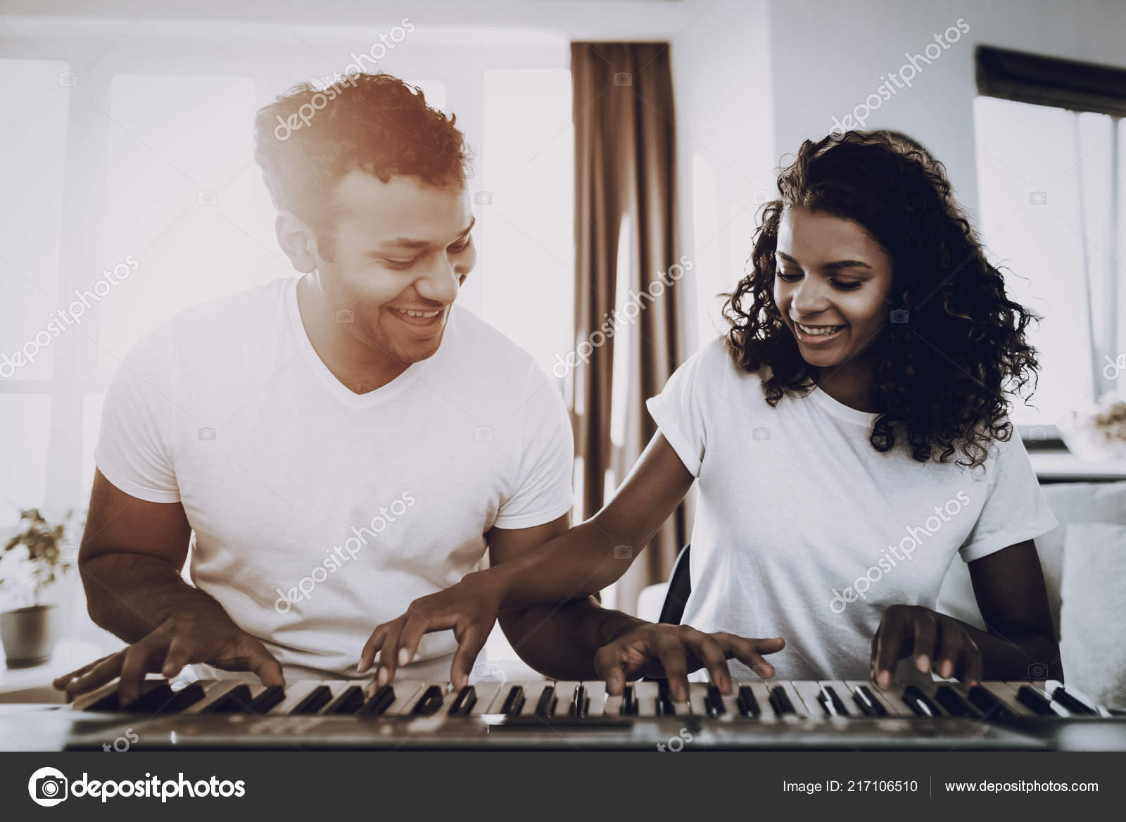 5ef2c4314ce Afro American Couple Synthesizer Playing Concept Happy Songwriter ...