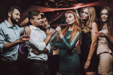 Best Singer. Musical Battle. Singing Songs. Smiling Girl. Have Fun. Beautiful Girls. Friends at Karaoke Club. Karaoke Club. Celebration. Young People. Party Maker. Girls Sing. Smile. Trendy Nightclub.