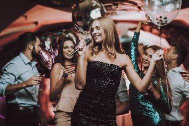 Singing Songs. Black Dress. Have Fun. Background. Trendy Nightclub. Cheerful. Smiling Girl. Singing Songs. Handsome Men. Beautiful Girls. Friends at Karaoke Club. Karaoke Club. Celebration.