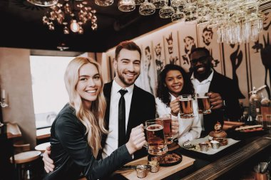 Beer. Two Guys. Girls. Bar. Drink Alcoholic Beverages. Different Races Communicate. Young People. Rest. Have Fun. Together. Clubbing. Nightlife. Joyful. Chin-chin. Leisure. Positive. Emotion.