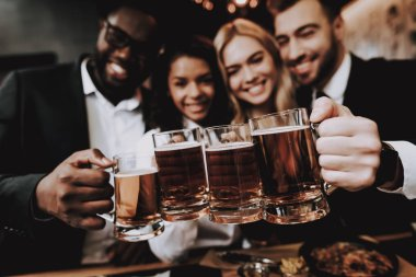 Two Guys. Girls. Chin-chin. Nightlife. Beer. Bar. Rest. Drink Alcoholic Beverages. Different Races Communicate. Young People. Have Fun. Together. Clubbing. Joyful. Leisure. Positive. Emotion.