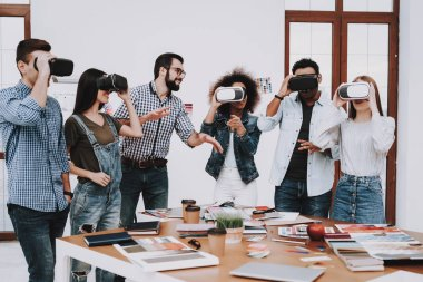 Fun. Virtual Reality Glasses. Look. Designers. Young Specialists. Choose Colors for Design. Teamwork. Discussion. Brainstorming. Design Studio. Multi-Ethnic. Project. Creative. Workplace.