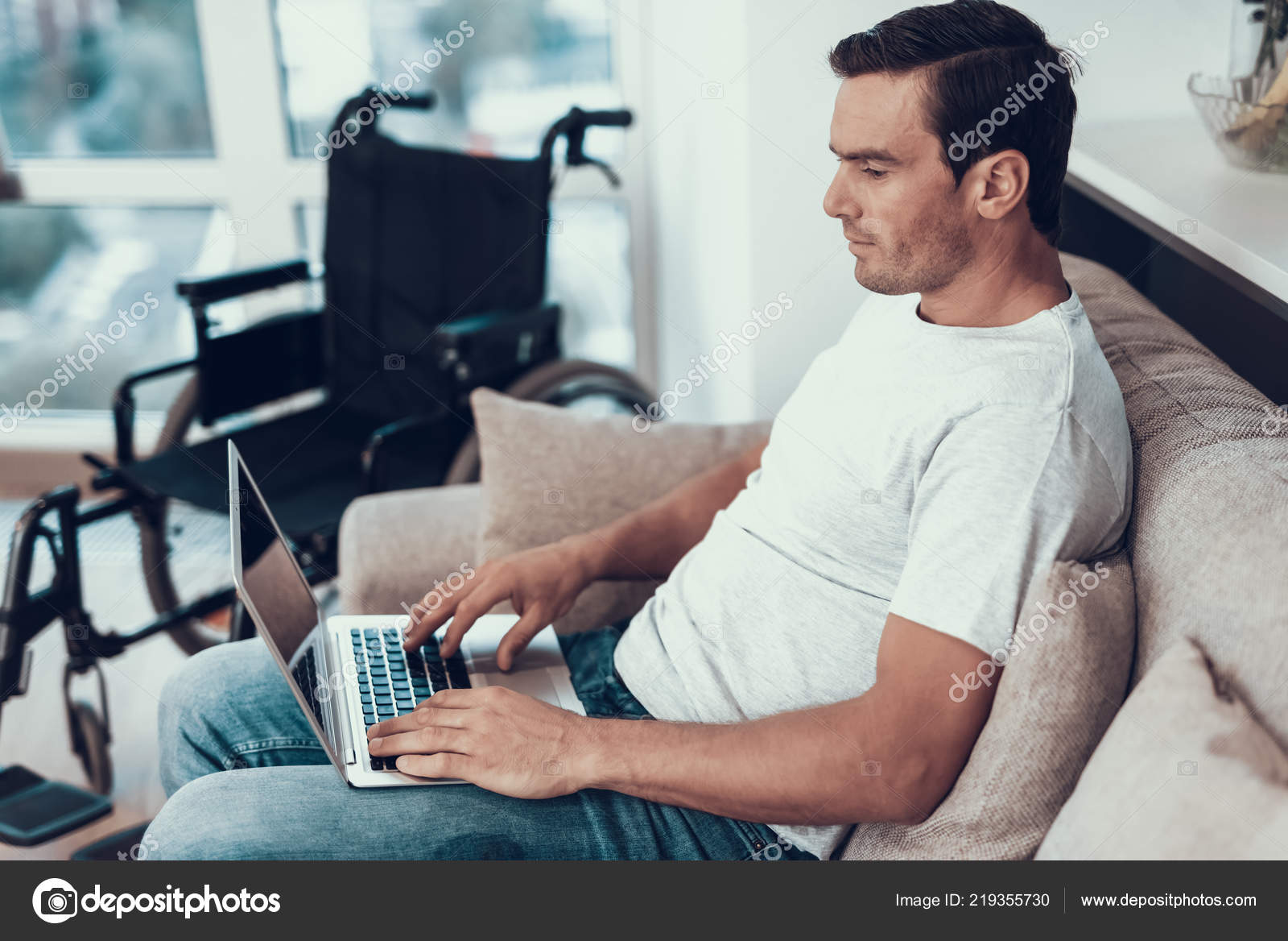 Awe Inspiring Disabled Man Sitting Sofa Typing Lap Handsome Smiling Person Onthecornerstone Fun Painted Chair Ideas Images Onthecornerstoneorg