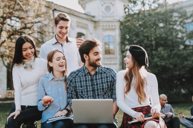 Group of Young People. Sit. Courtyard. University. Students. Study Together. Good Mood. Laptop. Textbooks. Have Fun. Notebooks. Friendship. Knowledge. Architecture. Freelance. Hipster.