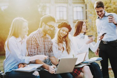 Study Together. Good Mood. Laptop. Knowledge. Architecture. Freelance. Hipster. Group of Young People. Sit. Courtyard. University. Students. Textbooks. Have Fun. Notebooks. Friendship.