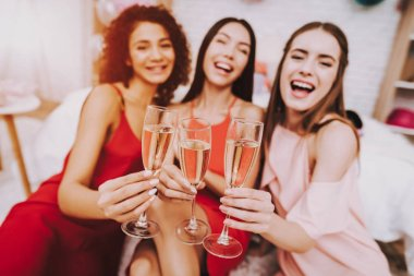 Glasses Champagne. Celebrating Women's Day. Emotional Young Women. Cheerful Women. Beautiful Girl. Womans Emotion. Champagne in Hands. International Women with Champagne. White Interior. Murch 8.