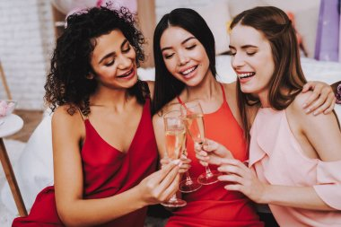 Glasses Champagne. Celebrating Women's Day. Emotional Women. Cheerful Women. Beautiful Girl. Womans Emotion. Champagne in Hands. International Women with Champagne. White Interior. Murch 8.