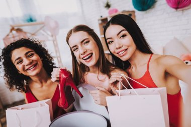 Red Dress. Make Selfies. Celebrating Women's Day. Emotional Women. Happy Woman. Gife Bag. Beautiful Girl. Womans Emotion. Shoes in Hands. International Women with Gifts. White Interior. Color Packs.