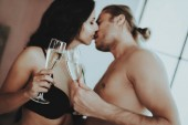 Brunette Girl. Person with Glasses Champagne. White Linens. Man on Bedroom. Woman with Sexy Man. Topless Man. Girl in Lingerie. Woman in Black Lingerie. Girl Kisses Man. He and She in Bedroom.