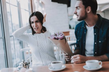 Serious Relationship. Restaurant. Break Down. Cafe.Girl. Refuses the Flowers. Apologizes. Misunderstanding. Relationship Problems. Bad Mood. Negative Emotion Concept. Conflict. Unhappy.