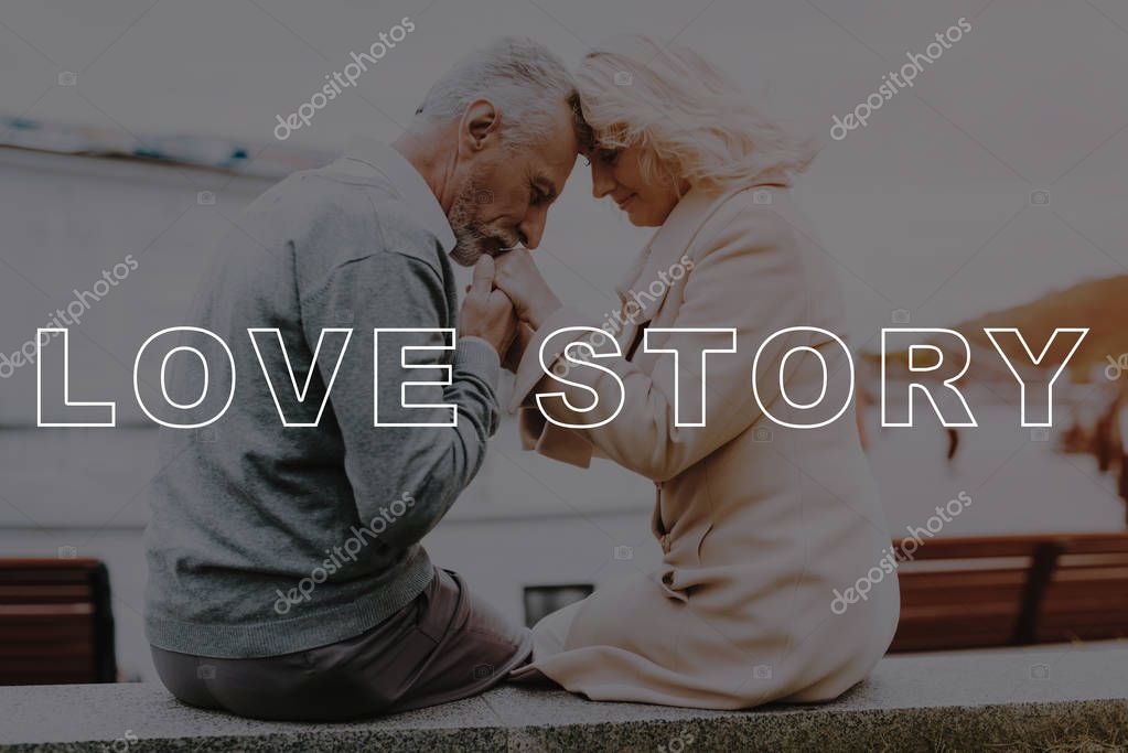 Hold Hands. Kisses Hands. Happy Together. Retired. Bubbly Relationships. Love Story. Relationships. Two Pensioners. Old Couple. Leisure Time. Have Fun. Alley in Park. Sit. Gift. Smiling. Summer.