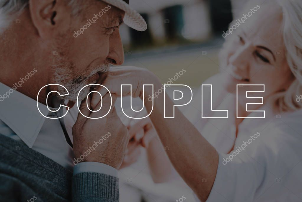 Old Couple. Kisses Hand. Bubbly Relationships. Walk. Love Story. Holding Hands. Beautiful Square. Sun. Elderly Man. Two Pensioners. Woman. Retired. Happy Together. Leisure Time. Have Fun.