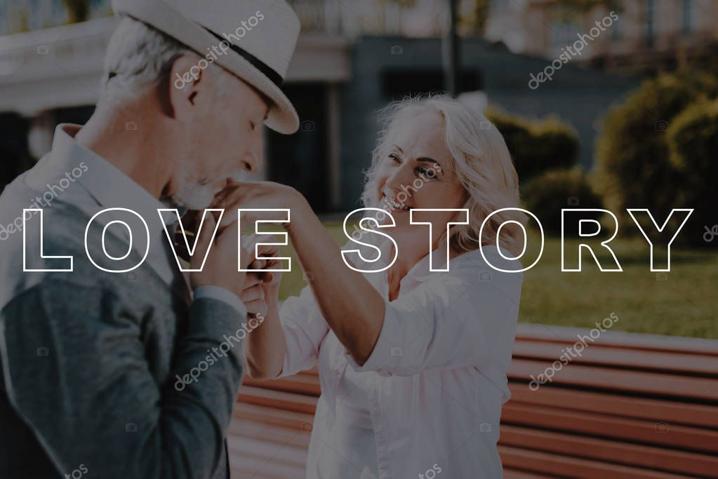 Love Story. Kisses Hand. Bubbly Relationships. Walk. Holding Hands. Beautiful Square. Sun. Elderly Man. Old Couple. Two Pensioners. Woman. Retired. Happy Together. Leisure Time. Have Fun.