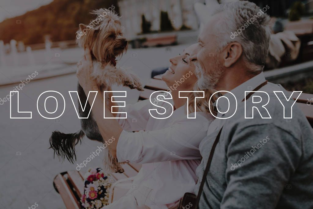Bubbly Relationships. Vintage Photo Camera. Little Dog. Two Pensioners. Old Couple. Walk. Happy Together. Love Story. Beautiful Square. Sun. Elderly Man. Woman. Retired. Leisure Time. Have Fun.