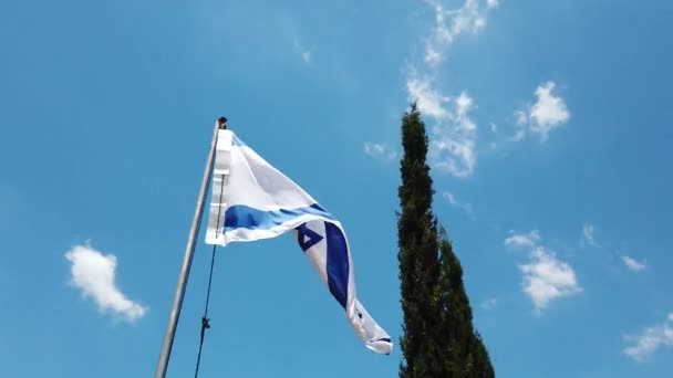 Flag of Israel waving in the wind, Sky and Sun Background.