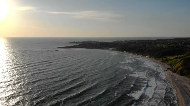 Aerial drone lateral motion footage morning sunrise over ocean. 4k