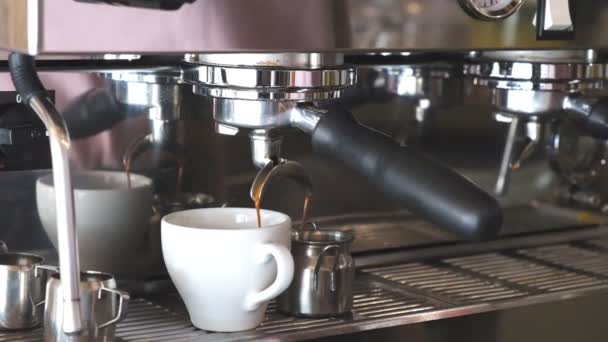 Making coffee in a coffee machine in a cafe. Barista prepares coffee professionally.