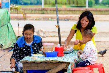yangon, myanmar. 16 th august, 2019: burmese vendor portrait at market