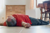Photo Man lying on the floor at home, epilepsy, unconsciousness, faint, stroke, accident  or other health problem, healthcare and medical concept