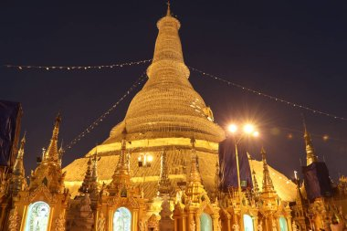 Night shot of The Shwedagon Pagoda, also known as the Golden Pagoda, Yangon Myanmar. It is a gilded stupa in Undergoing restoration.