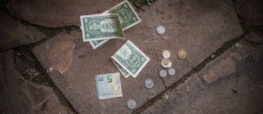 Concept of poverty, and destitution, money and coins. Poor people