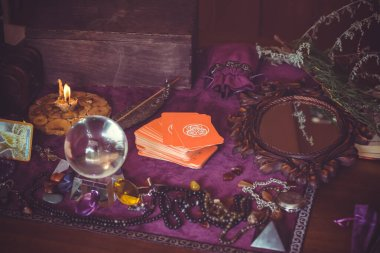 Europe, Ukraine. Kiev July 20 : Illustrative Editorial. Tarot cards, Concept of fortune telling and predictions, magical rituals and wicca elements on a table stock vector