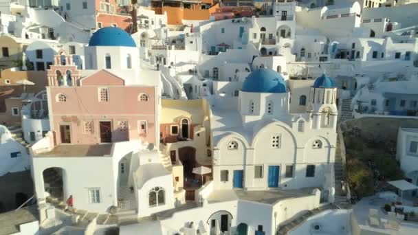 Aerial view flying over city of Oia on Santorini Greece