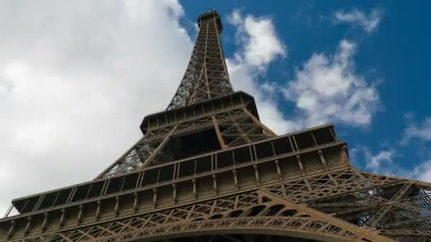 Eiffel tower blue sky with clouds down to top view hyperlapse
