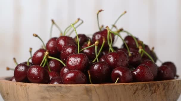 Fresh, ripe, juicy cherries in a wooden bowl, rotation zoom in. Food background.