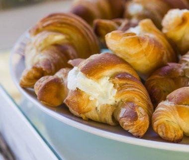 mountain of savory croissants with cream cheese and ham foam