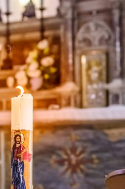 Paschal candle illuminates the altar and tabernacle and never leaves only the heart of Jesus