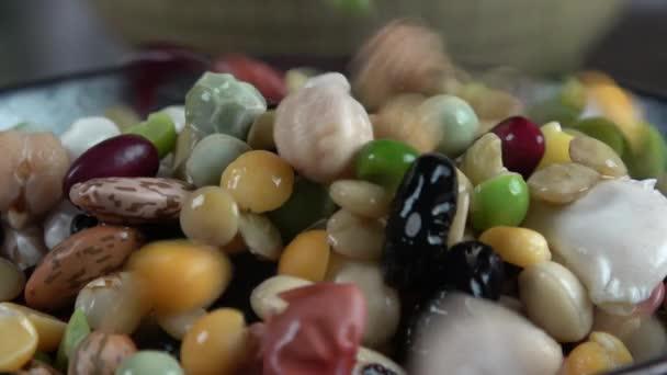 Colorful legumes falling macro closeup
