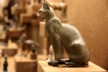 Saint petersburg, Russia - SEP 13, 2016: ancient bronze statue of goddess Bastet as a cat from old Egypt. Side view at the hermitage museum in Saint Petersburg, Russia.