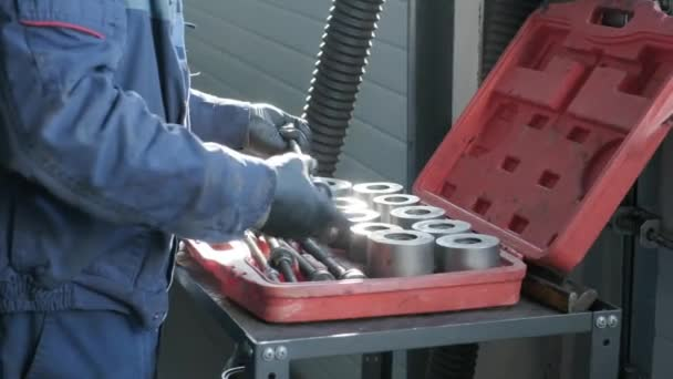 Mechanic choosing Set of tools . Screwdrivers in the case. Repair