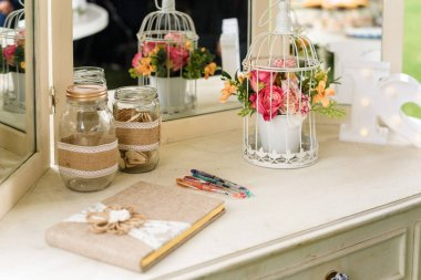 White furniture as wedding decoration with vintage objects