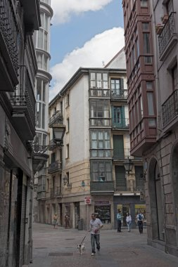 BILBAO, SPAIN-JULY 26, 2018: people in the narrow streets of the historic old town of bilbao, spain.