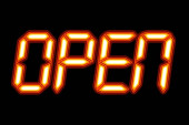 Photo A digital OPEN sign with orange glow for use as a store sign or design element.