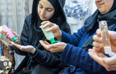 Arabic muslim family using hygiene products