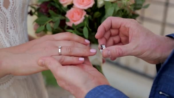 A man puts an engagement ring on the hands of his beloved. Close - up of hands.