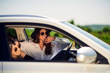 Two young women having fun driving