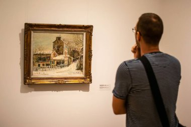 Belgrade,Serbia-July 10,2018.Image shows a man observing a painting at the National museum of Serbia.