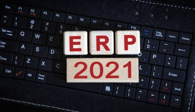 ERP 2021 concept. Wooden cubes on a black keyboard