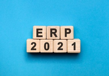 ERP - text concept on wooden cubes with gradient blue background